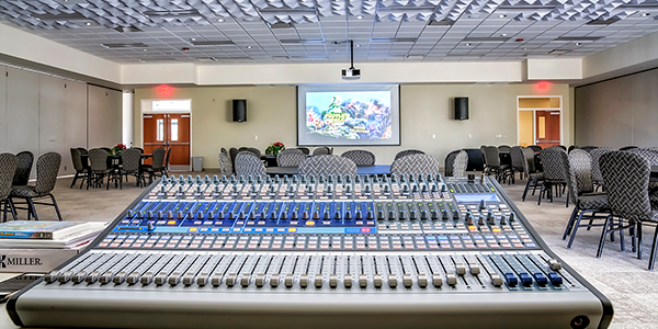 digital console within large conference room